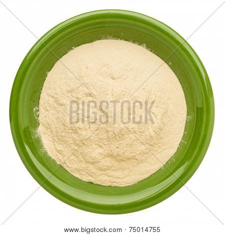 baobab fruit powder  on an isolated green bowl