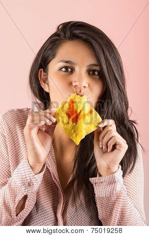 young brunette girl eating chinese wonton cracker snack