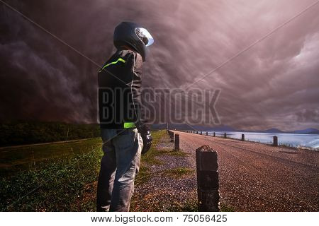Biker Standing With Its Motorbike On Storm