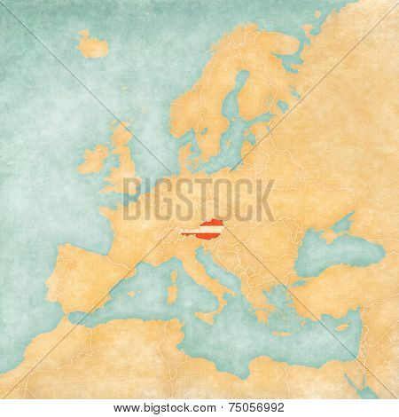 Austria (Austrian flag) on the map of Europe. The Map is in vintage summer style and sunny mood. The map has a soft grunge and vintage atmosphere which acts as watercolor painting on old paper.