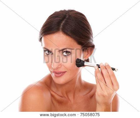 Beautiful Woman Applying Facial Care Product