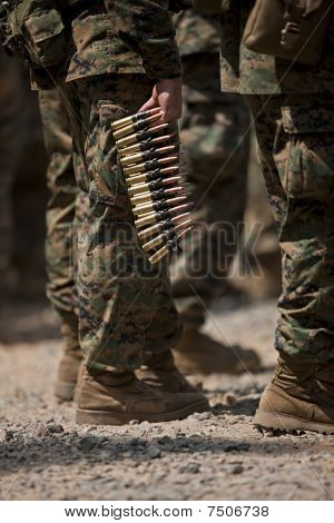 U.S. Marine with Tracer Machine Gun Rounds Awaiting Orders.