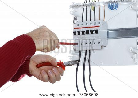 Man Works On An Electrical  Junction