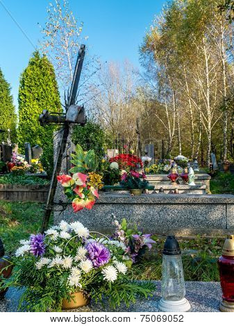 Rows of graves decorated with floral tributes at the catholic cemetery