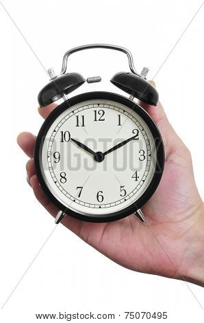 a man hand holding a typical mechanical alarm clock on a white background