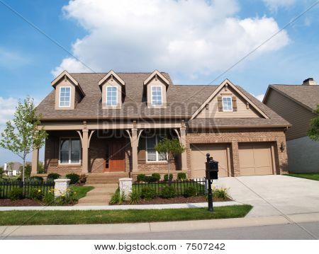 Small Two Story Brick Home with Garage and Porch