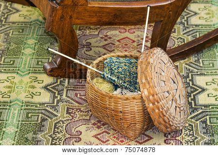 Knitting In Wicker Basket On Floor