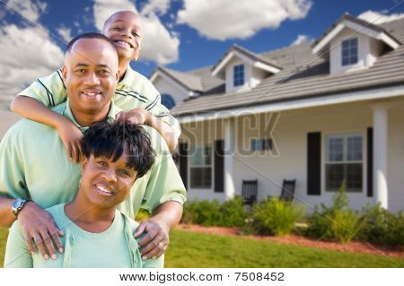 Attractive African American Family in Front of Beautiful House. poster