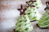 Close up of green christmas tree meringues