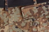A open pocket on fall camouflage army uniform poster