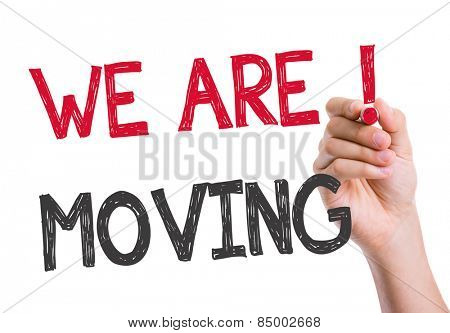 We Are Moving written on the wipe board