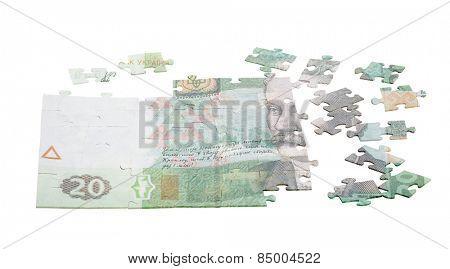 unfinished puzzle from twenty hryvnas isolated on white background