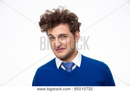 Young man expressing disgust over white background poster