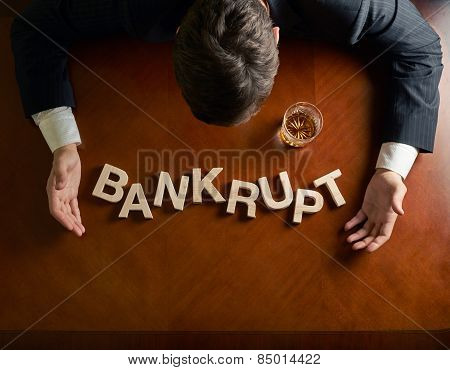 Word Bankrupt and devastated man composition