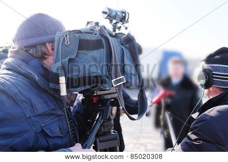 Cameraman at work poster