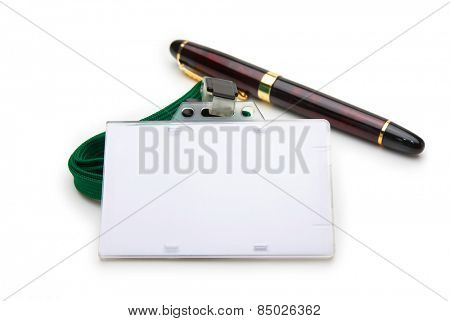 Blank ID or security card with green neck strap , and pen isolated on white. For adding your text of your choice.