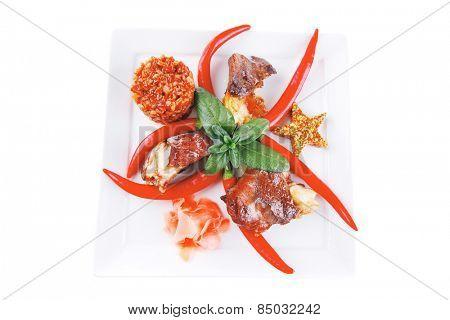 roast beef chunks on white dish over white