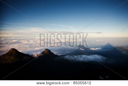 Shadow of the conical mountain Adam's Peak - sacred buddhist place. Sri Lanka poster