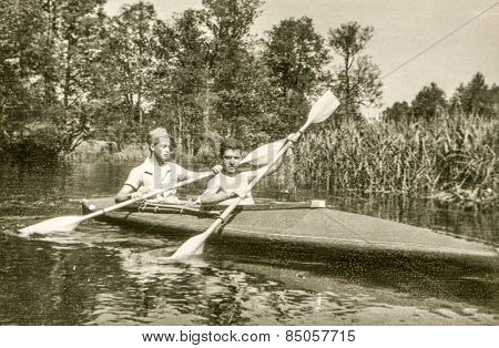 Vintage photo of young men during a canoe trip (1960's)