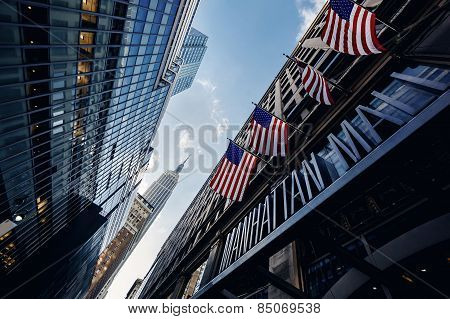 Below view from street on Empire state building in New York, USA poster