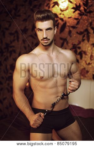 Sexy Macho Man With Handcuffs In Hotel Room