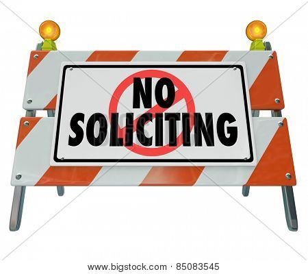 No Soliciting words on a barrier, blockade or sign to illustrate blocking annoying salespeople from selling to and annoying you