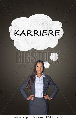 Conceptual Career Text on White Speech Bubble Above Smiling Young Businesswoman Posing in front Abstract Gray Gradient Background.