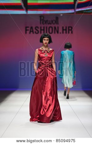 ZAGREB, CROATIA - OCTOBER 18, 2014: Fashion model wearing clothes designed by Robert Sever on the 'Fashion.hr' fashion show