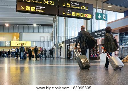 VALENCIA, SPAIN - NOVEMBER 17, 2014: Airline passengers inside the Valencia Airport. About 4.98 million passengers passed through the airport in 2013.