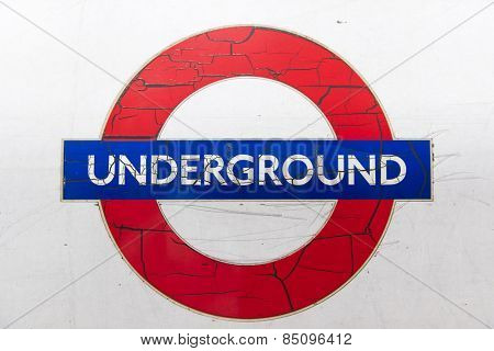 LONDON, UK - London JANUARY 31: Details of run down logo of the London Underground, with paint cracking and peeling off. January 31, 2015 in London.