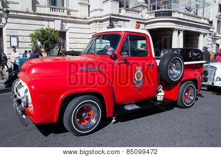 VALENCIA, SPAIN - MARCH 6, 2015: A red classic Ford F 100 truck at the XLV Rally Fallas de Coches de L Antigor in the streets of Valencia.