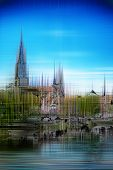 Artistic image of Ulm Minster with a blurred paint effect of the Gothic cathedral and Ulm under a sunny blue sky reflected in the River Danube poster
