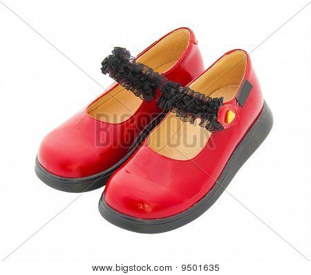Red Patent Leather Baby Shoes With Black Tape. Isolated