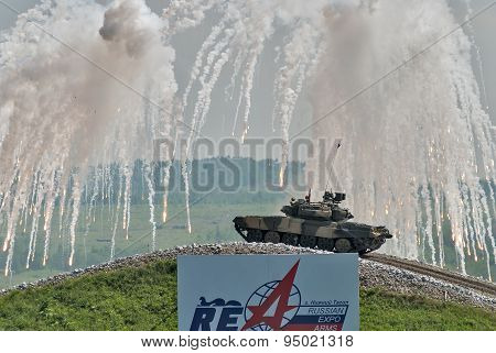 Russian tank T-80 makes smoke screen from enemy