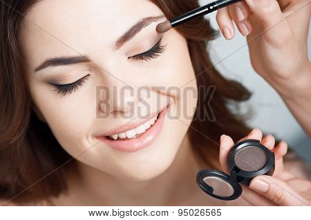 Beautiful young girl is preparing for date