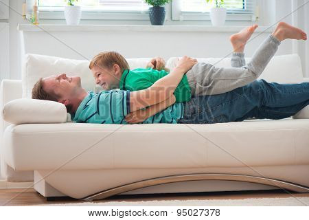 Little Boy Having Fun With Father At Home