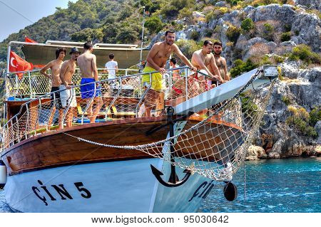 Turkish Tourists Relaxing On Deck Excursion Yacht, Sunny Summer Day.