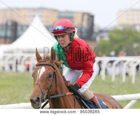 Female Jockey Riding A Horse Race