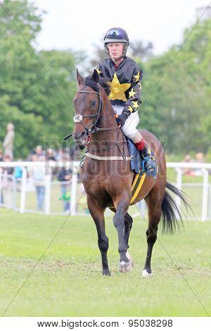 Female Jockey Sitting On Her Race Horse