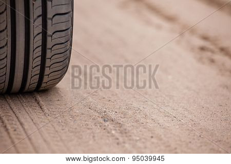 trace of rubber tires SUV in the desert sand. Riding a four-wheel drive vehicles passable attracts m