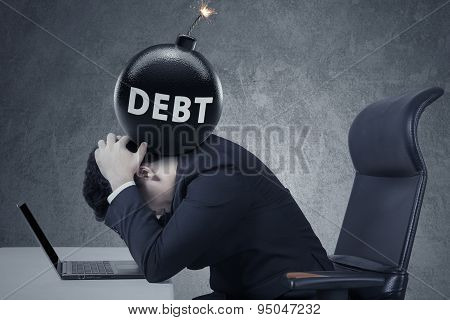 Bomb Of Business Debt On Businessman Head