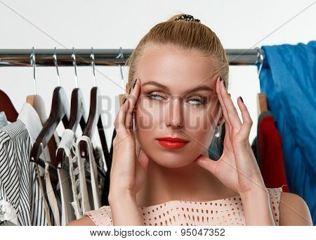 Beautiful Blonde Woman Suffering Near Wardrobe Rack