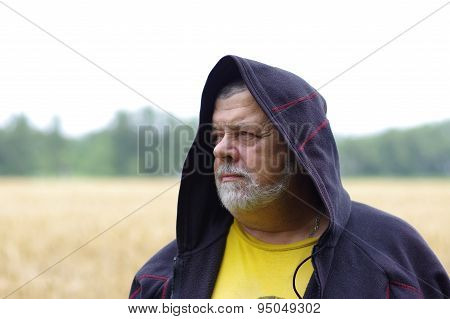 Outdoor portrait of a senior man in cowl