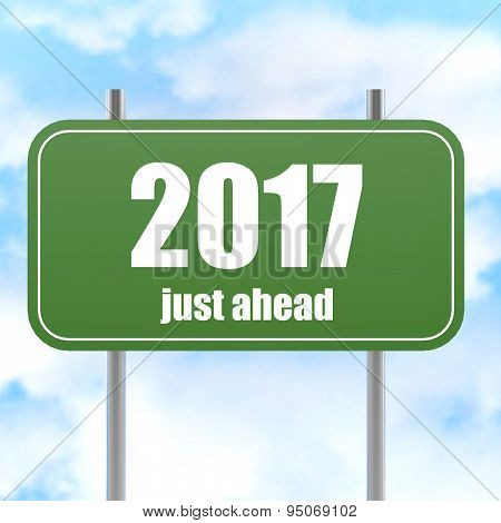 Street Sign With 2017 Just Ahead In Blue Sky