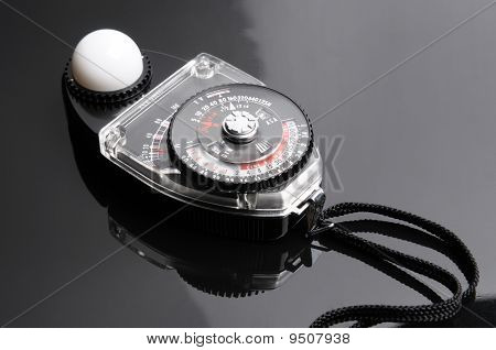 A device used to measure the amount of light. A light meter is often used to determine the proper exposure for a photograph poster