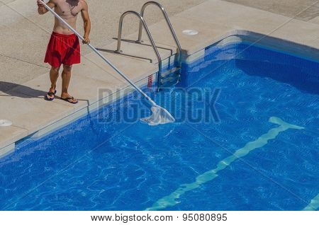 Guy Cleaning The Swimming Pool