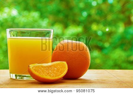 Orange and glass on the table