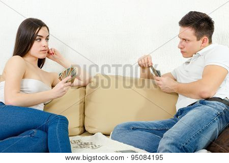 Sceptic Young Couple Cheating Each Other In Card Game