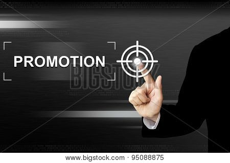 Business Hand Pushing Promotion Button On Touch Screen