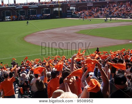 Fans Wave Orange Towels To Pump Up Team Before The Start Of The Game